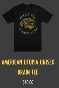 Black t-shirt with white text that reads Here's The Connection encircling an image of a human brain in yellow.